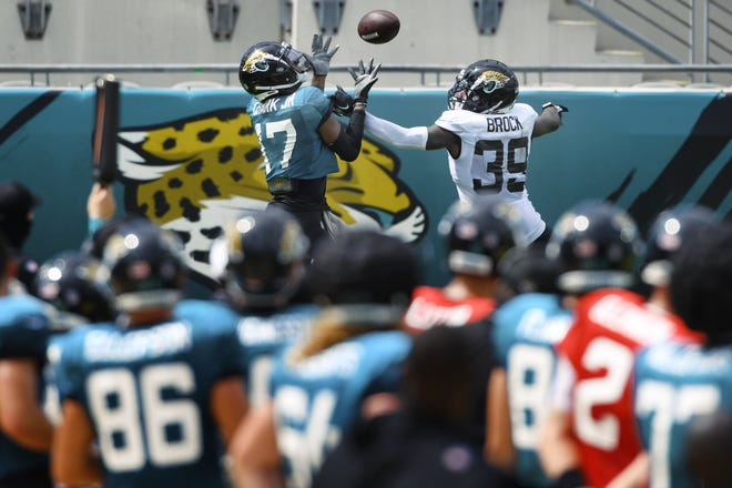 Jaguars wide receiver DJ Chark Jr. (17) goes up for a catch in the end zone while being defended by cornerback Tramaine Brock during Saturday's scrimmage in TIAA Bank Field.