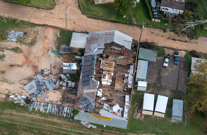 Damage to a roof from Hurricane Laura is seen Friday in Pineville, La., during Gov. John Bel Edwards' aerial tour of stricken areas in the northern part of the state.