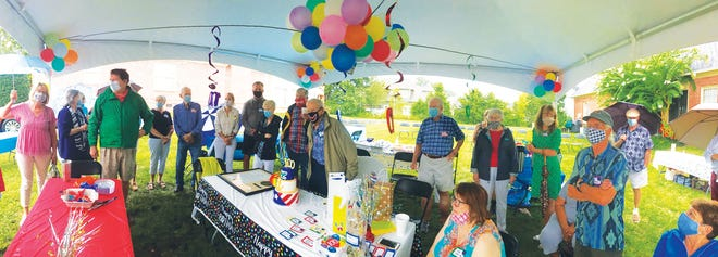 Well-wishers gathered under a tent and wore masks to celebrate the 100th birthday of Oak Ridge resident Ken Beyer last Saturday.