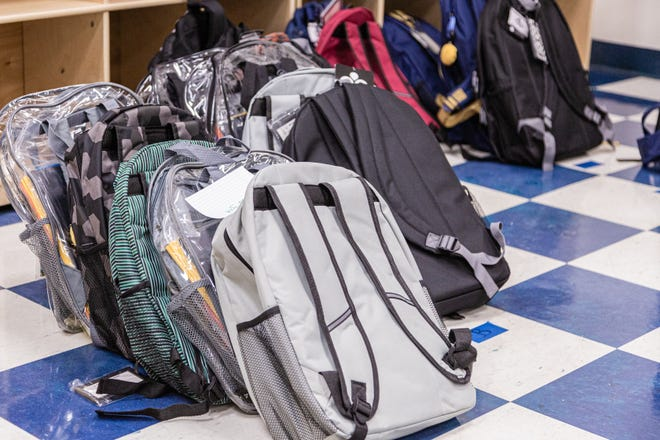 Backpacks of school supplies sit waiting to be picked up at the Colony Youth Center in Palm Beach Gardens on Saturday. Back to School PBC! has partnered with several agencies to provide about 10,000 students with school supplies and food.