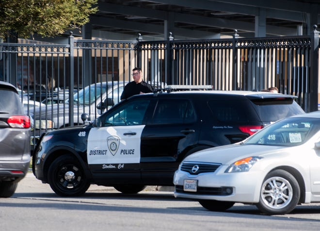 A SUSD police patrol vehicle stands at the entrance to Edison High School in Stockton. Last June, theStockton Coalition For Shared Safety called on Stockton Unifiedto abolish its Police Department. A proposal was briefly considered, then removed for later discussion. The department has since been rebranded the Department of Public Safety.