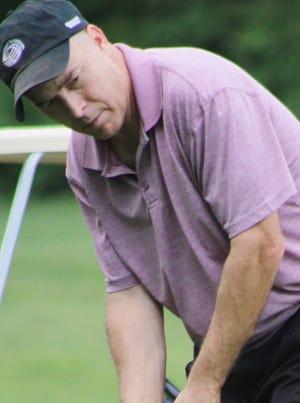 Geoffrey Burge of Aurora competes in the opening round of the Portage County Senior Amateur on Saturday at Sugar Bush Golf Club in Garrettsville.