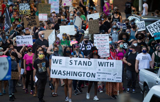 Hundreds join a Solidarity March through the streets of Eugene Friday August 28, 2020.