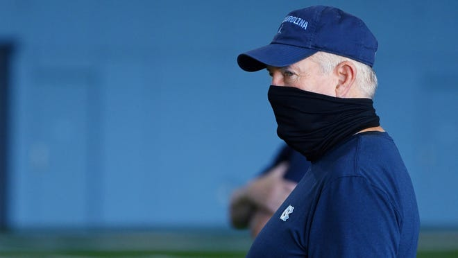 Coach Mack Brown looks on during a North Carolina preseason football practice earlier this month at the team's indoor facility.