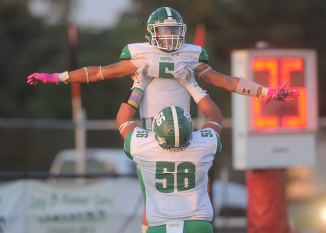 Wall offensive lineman Luke Lipsey lifts running back Chase Rios following Rios' first touchdown against Eastland on Friday, Aug. 28, 2020, at Maverick Stadium in Eastland.