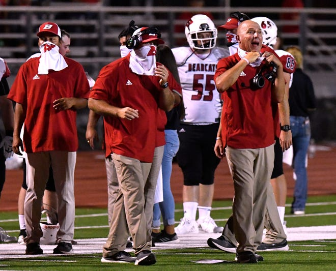 Ballinger coaches call to their players through their face coverings during Friday's game against Jim Ned in Tuscola August 28, 2020. Final score was 20-14, Ballinger.