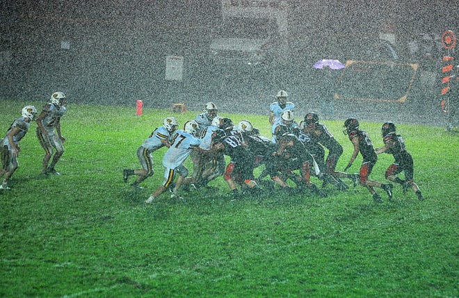 Storms forced teams all across the region into a different type of football than they would normally play in many cases, as Waynedale and Dalton (pictured) learned during their rain-soaked contest.