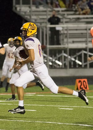 Unioto's Maddox Fox makes a last minute touchdown to secure the game winning score of 44-38 Friday night at Piketon High School on August 28, 2020.