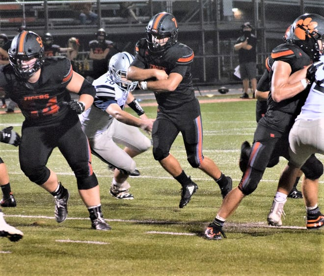Waverly's Jaxon Poe carries the ball against visiting Granville Friday night. The Tigers pulled out a 36-35 non-conference win.