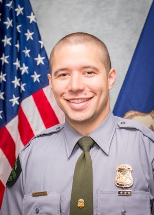 Michigan Department of Natural Resources Conservation Officer Robert Slick was exercising off-duty Wednesday, Aug. 26, 2020, when he saw a mobile home in Spring Lake engulfed in flames. Slick and a neighbor were able to rescue the woman from the burning structure; Slick carried her to a porch and waited with her until EMS arrived.