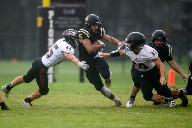 Boonville's Devin Mockobee, blasting for yardage against Southridge, eclipsed the 400-yard barrier in the Pioneers' 43-35 loss to Gibson Southern on Friday night.