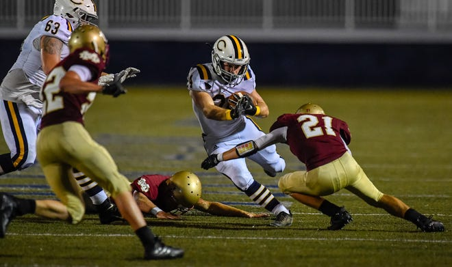 Castle's Connor McIntire (24) runs for daylight against Mater Dei in the Knights' 6-3 victory on Aug. 28 at Reitz Bowl.