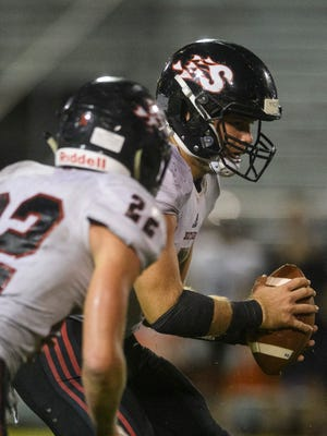 Southridge's Chase Taylor (5) prepares to make a hand-off to Southridge's Matt Springer (22) during the third quarter against the Boonville Pioneers take on the Southridge Raiders at Boonville High School in Boonville, Ind., Friday, Aug. 28, 2020. The Pioneers fell 28-0 to the Raiders.