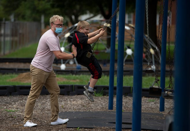 Gavin Webster propels third-grader Jimmy Vann Jr. during a recess at Delaware Elementary School Thursday afternoon, Aug. 27, 2020. Webster is in his third week as a Peacemaker, a program his employer, Dream Center, started in 2018 to help children in the neighborhood.