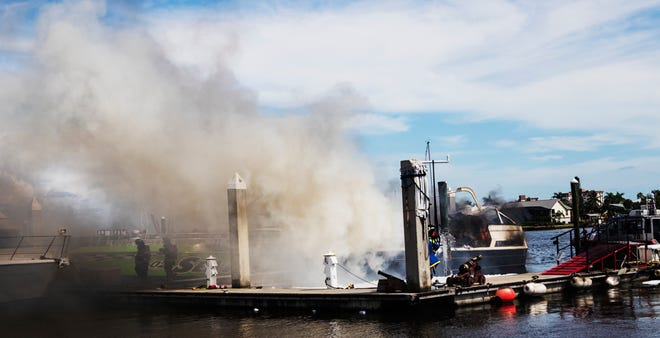Firefighters from multiple agencies along with emergency officials responded to a boat fire at Salty Sam's Marina on Fort Myers Beach. The cause of the fire is under investigation. A man and his dog live on the boat and they were not injured.