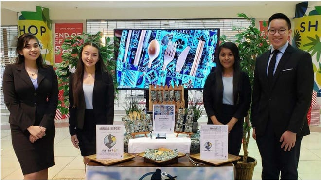 Pasiadot members, from left, Alex Smith, Aura Griffith, Tyra Delos Reyes and Kiran Toh at the January 2020 Junior Achievement Guam Company of the Year Competition. The team won the FedEx Global Possibilities Award at the 2020 Junior Achievement Asia Pacific Company of the Year Competition.