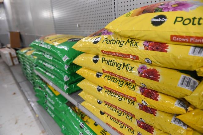 Bags of garden soil are stacked in the Mark's Hardware gardening section, Hagåtña, Aug. 29, 2020.