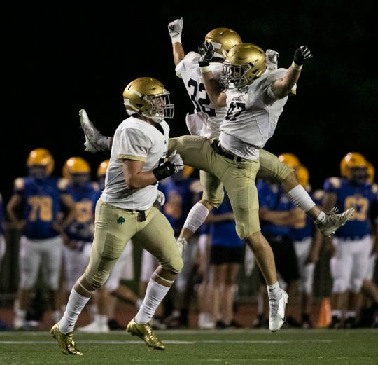 Cathedral Fighting Irish celebrate an interception at Carmel High School Football Stadium in Carmel, Ind., Friday, August 28, 2020. Cathedral Fighting Irish defeated Carmel Greyhounds, 44-28.