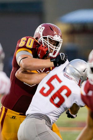 McCutcheon's Kolby Borders (60) blocks West Lafayette's Connor Barket (56) during the third quarter of an IHSAA football game, Friday, Aug. 28, 2020 in Lafayette.
