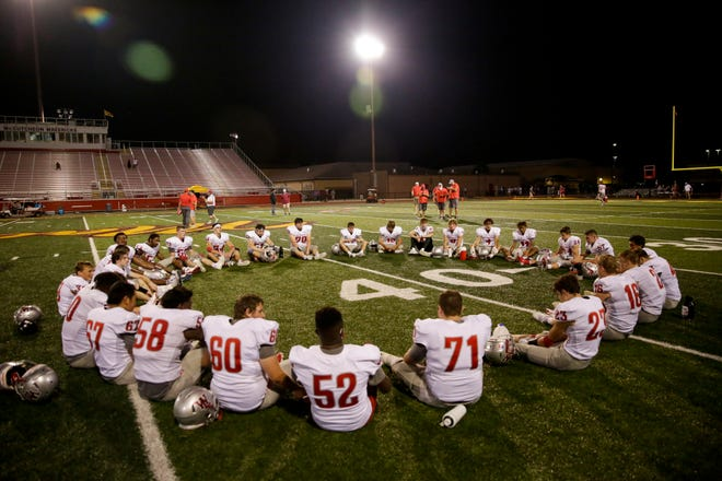 West Lafayette sit in a circle after defeating McCutcheon, 41-3, Friday, Aug. 28, 2020 in Lafayette.
