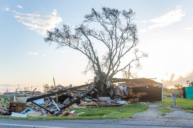 Debris twisted around a tree from Hurricane Laura near Hackberry, LA.  Saturday, Aug. 29, 2020.