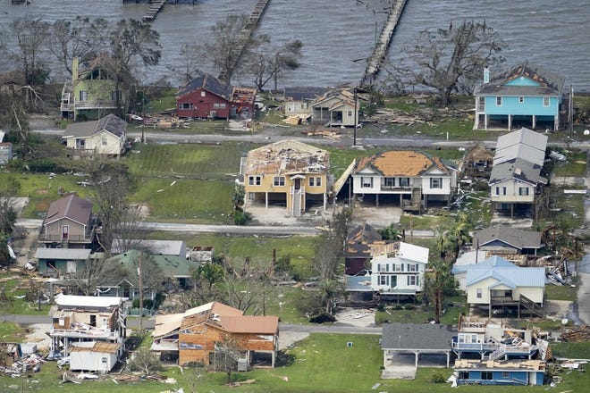 Buildings and homes damaged by Hurricane Laura are seen from the air Thursday near Lake Charles.