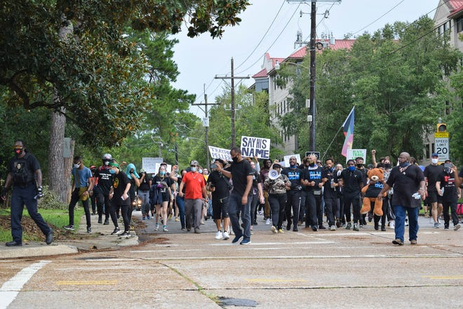 Protesters marched down Johnston St. to UL, down St. Mary and to the Alfred Mouton Statue Saturday afternoon. August 29, 2020  STACY CONRAD? SPECIAL TO THE ADVERTISER
