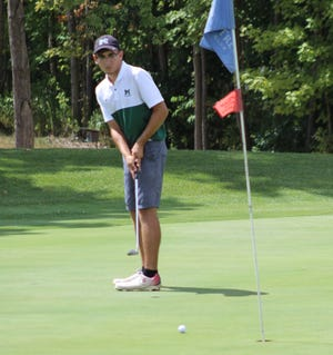 Will Laskey of the host Rams watches his putt during Friday's Madison Invitational at Oak Tree