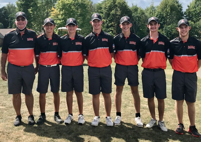 Dan Priest's Ashland Arrows won Friday's 13-team Madison Invitational, with Tyler Sabo (far right) taking medalist honors with a 69 at Oak Tree