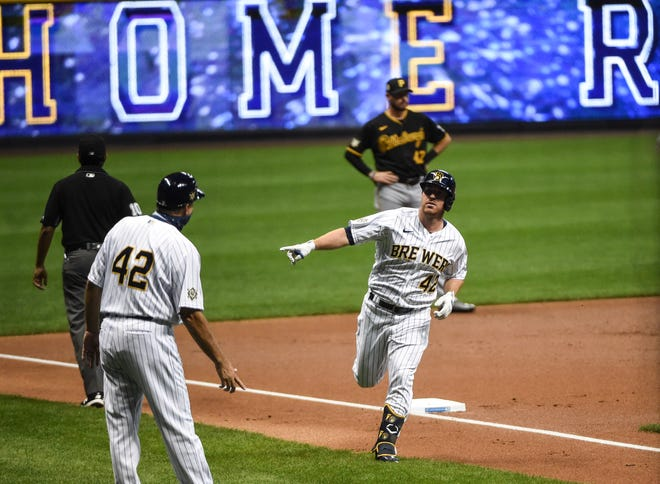 Brewers first baseman Jedd Gyorko rounds third base after hitting a solo home run in the first inning.