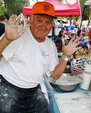 Rod Lindsay, shown cooking at an event in this undated photo, was a longtime Shasta Lake civic leader and Native American community advocate. Lindsay died on Aug. 27, 2020. (Photo credit: Rose Betchart Smith)