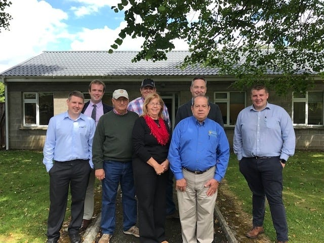 Enrique Gandara, in bright blue DATCP shirt, accompanied a group of Wisconsin Angus breeders to an international Angus forum in Scotland and Ireland. His work, sponsored by U.S. Livestock Genetics Export, Inc., was designed to build ties between state beef breeders and farmers in other countries.