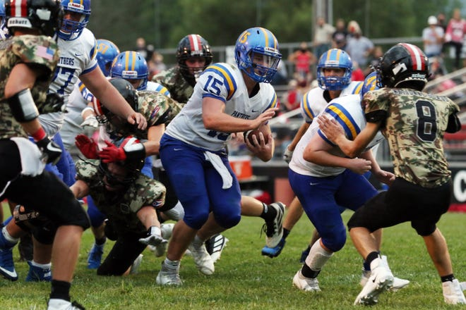 Maysville quarterback Kaiden Hall bursts through the Crooksville defense on his way to the end zone in Week 1 at Village Park. Changes to the playoff system in 2020, due to COVID-19, allowed teams like the Panthers and Ceramics back in the postseason for the first time in years.