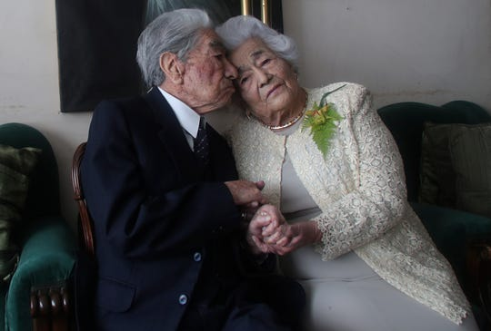 Married couple Julio Mora Tapia, 110, and Waldramina Quinteros, 104, both retired teachers, pose for a photo at their home in Quito, Ecuador, Friday.