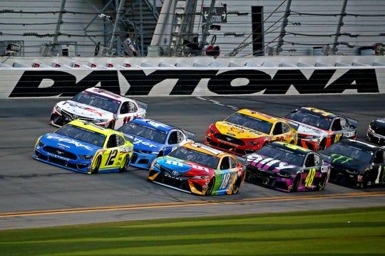 Kyle Busch (18), Ricky Stenhouse Jr. (47), Ryan Blaney (12) and Denny Hamlin (11) fight for the lead during the 2020 Daytona 500.