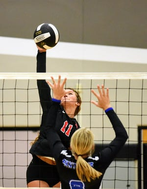 Reagan Vogelaar goes up for a kill attempt during Roland-Story's opening match with Central Springs at the Norse quadrangular meet Aug. 24 in Story City.
