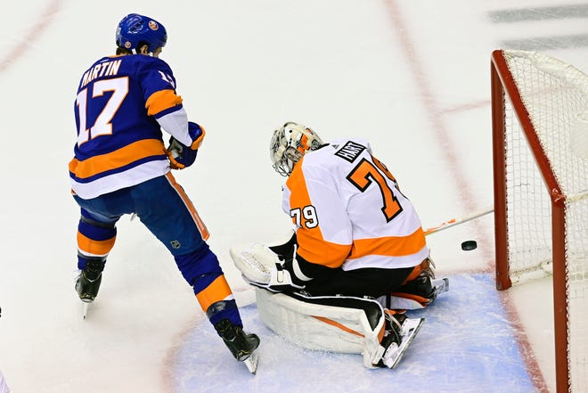 Islanders left wing Matt Martin scores on Flyers goaltender Carter Hart during second period of Game 3 on Saturday night.
