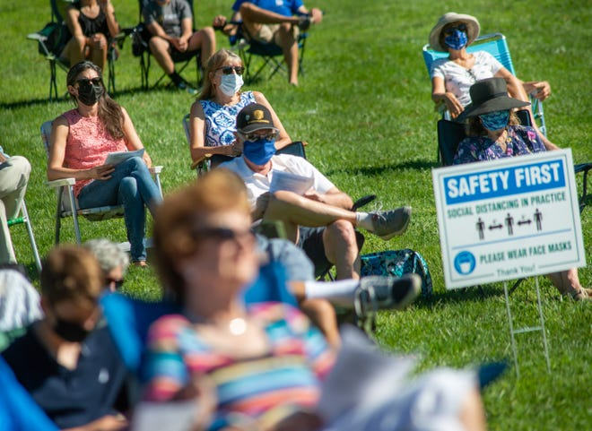 Congregation members worship near a safety first sign during an outdoor church service held by Doylestown Presbyterian Church on Sunday, August 30, 2020 at Central Park in Doylestown. It was the first time since March that the congregation has been able to worship at the same location due to COVID-19 restrictions. Masks were required for social distancing in an effort o maintain health and safety protocols.