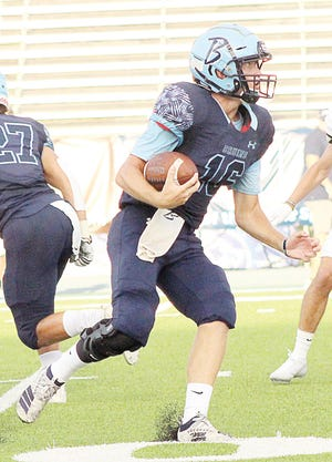 Bartlesville High School quarterback Paxton Bradford makes a red zone run during Thursday's football scrimmage action at Custer Stadium.