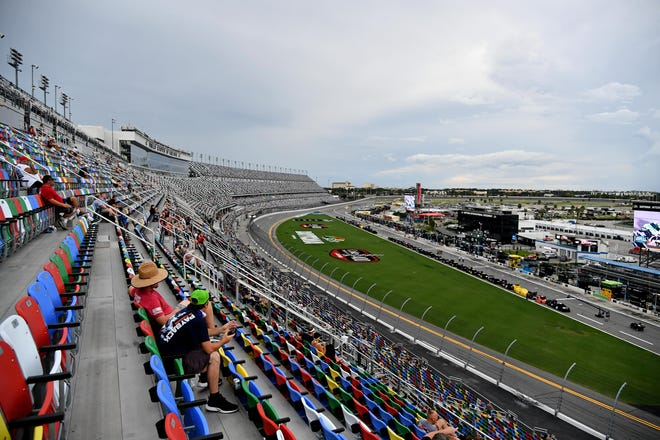 Socially distanced fans await the start of the Coke Zero Sugar 400 at Daytona International Speedway. Volusia County hoteliers said that the race didn't generate as much business as they had initially hoped in its first August running.