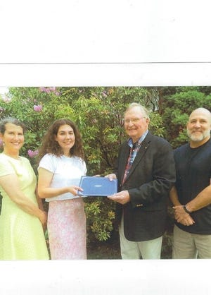 Hannah Rose Keally, second from left, received this year's $5,000 scholarship from the Lincoln High School Class of 1957's class president James Meehan, third from left. They are bookended by her parents, Katy and Frank Keally.