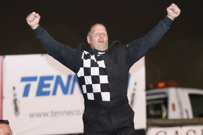 Dennis LaVeine, West Burlington, celebrates his modified feature race win and and the 2020 modified track points championship Saturday at 34 Raceway.