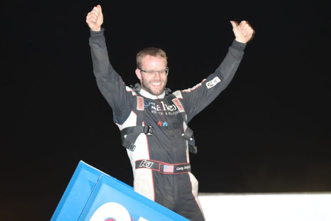 Cody Wehrle, Burlington, celebrates his 305 sprint feature win and his 2020 305 sprint track points championship at 34 Raceway Saturday.