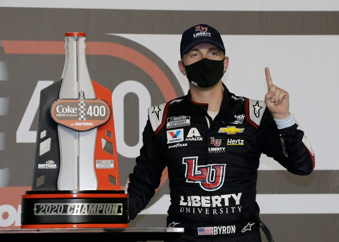 William Byron stands with his trophy in Victory Lane after winning the NASCAR Cup Series auto race at Daytona International Speedway on Saturday in Daytona Beach.