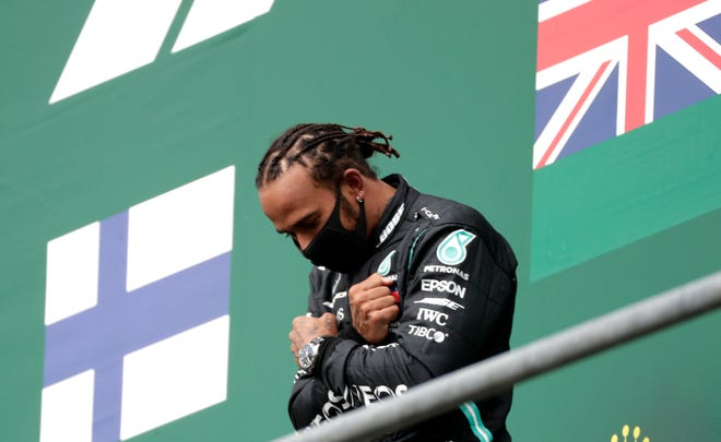 Mercedes driver Lewis Hamilton of Britain celebrates on the podium after winning the Formula One Grand Prix at the Spa-Francorchamps racetrack in Spa, Belgium, on Sunday.