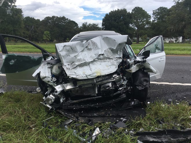 A Hyundai sits aside U.S. 441 following a head-on crash Sunday afternoon about 15 miles north of Ocala, which claimed the life of one person and sent several people to area hospitals.
