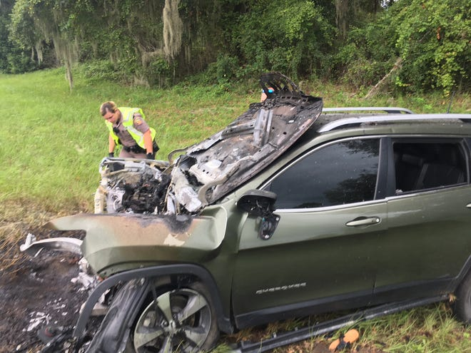 Florida Highway Patrol officials look over a Jeep SUV involved in a head-on crash Sunday afternoon about 15 miles north of Ocala on U. S. 441. The Jeep SUV was traveling northbound when the driver lost control as the vehicle crossed the median and struck a Hyundai that was traveling southbound.