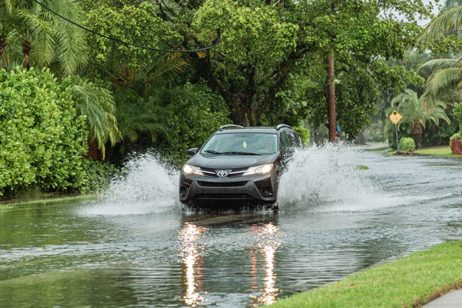 Late afternoon thunderstorms unleashed a deluge of rain in West Palm Beach on Sunday, August 30, 2020. Parts of South Flagler Drive were flooded from the rain. [JOSEPH FORZANO/palmbeachpost.com]