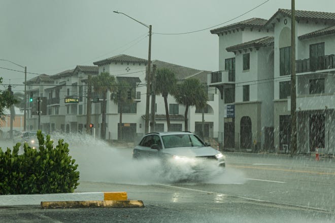 Late afternoon thunderstorms unleashed a deluge of rain in West Palm Beach on Sunday, August 30, 2020. Parts of South Dixie Highway were flooded from the rain. [JOSEPH FORZANO/palmbeachpost.com]