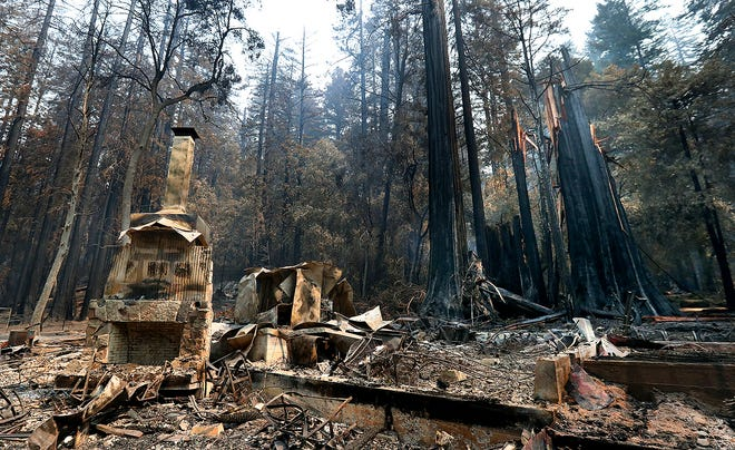 The fireplace of the Nature Lodge Museum and Store at Big Basin Redwoods State Park stands among the devastation in Boulder Creek wrought by the CZU August Lightning Complex, which destroyed nearly all buildings and burned thousands of trees at the park.